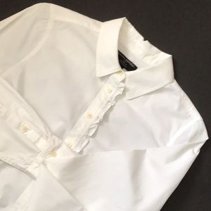 White blouse with ruffle.